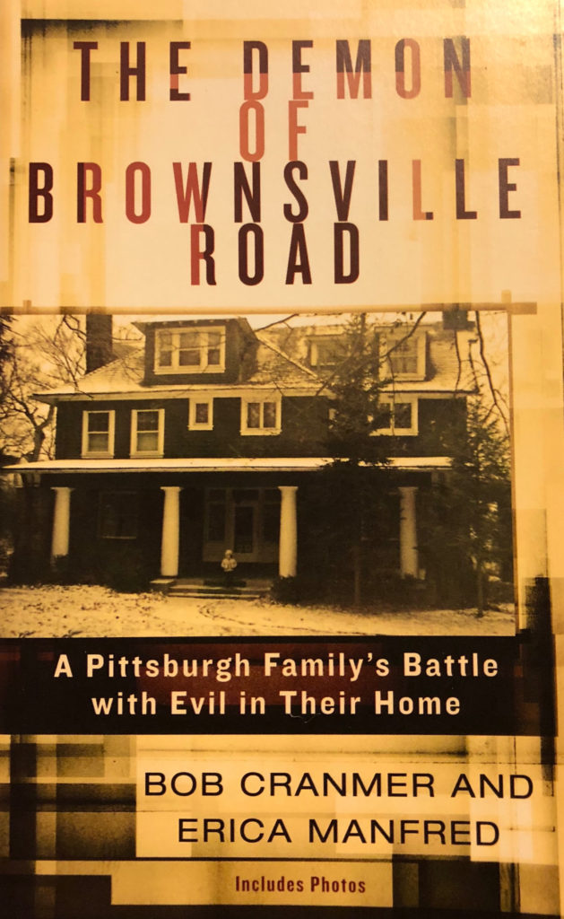 Book Jacket for The Demon of Brownsville Road with image of house